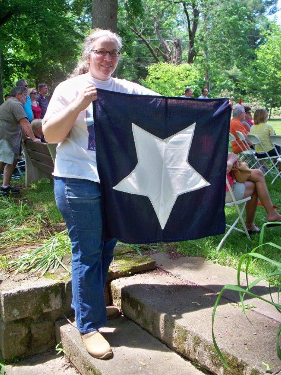 Sybil with flag